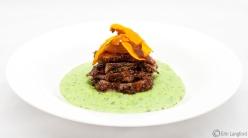 Herb Crusted Roast Lamb, with Minty Pea & Potato puree, roast onion gravy and pumpkin ribbons
